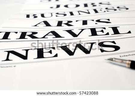 An image of a pen and headlines of newspaper - stock photo