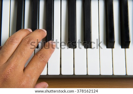 An image of a piano playing background - stock photo