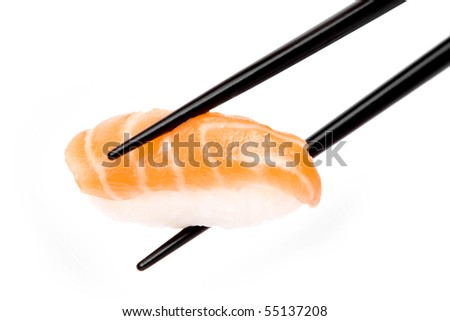 An image of a piece of sushi in black chopsticks