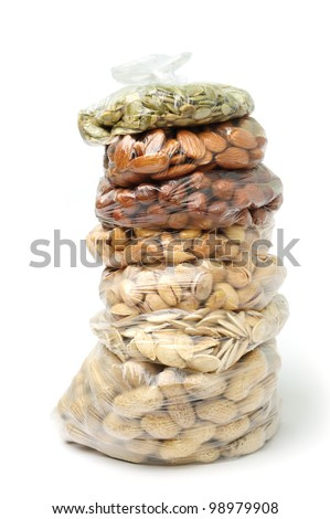 An image of a pile of bags with nuts and seeds - stock photo