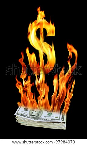 an image of a pile of dollar bills on fire - stock photo