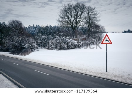 An image of a road in a winter scenery - stock photo