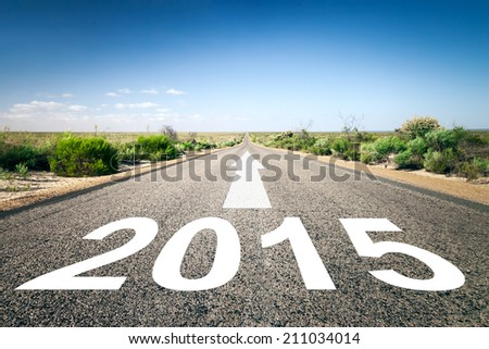 An image of a road to the horizon with text 2015 - stock photo