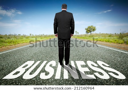 An image of a road to the horizon with text business - stock photo