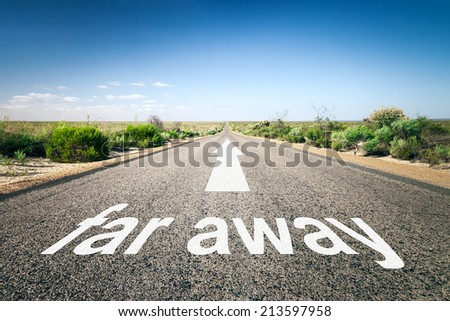 An image of a road to the horizon with text far away - stock photo