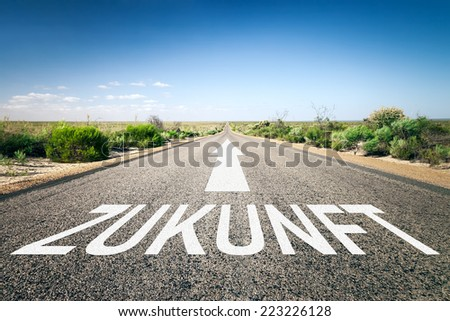 An image of a road to the horizon with text future in german language - stock photo
