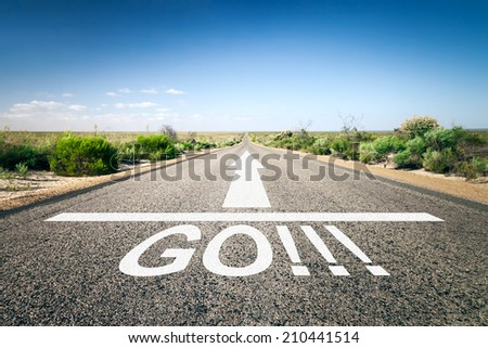 An image of a road to the horizon with text go - stock photo