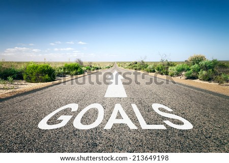 An image of a road to the horizon with text goals - stock photo