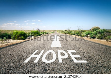 An image of a road to the horizon with text hope - stock photo