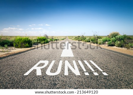 An image of a road to the horizon with text run - stock photo