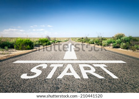 An image of a road to the horizon with text start - stock photo