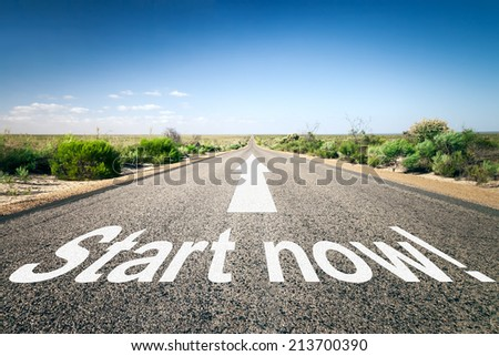 An image of a road to the horizon with text start now! - stock photo