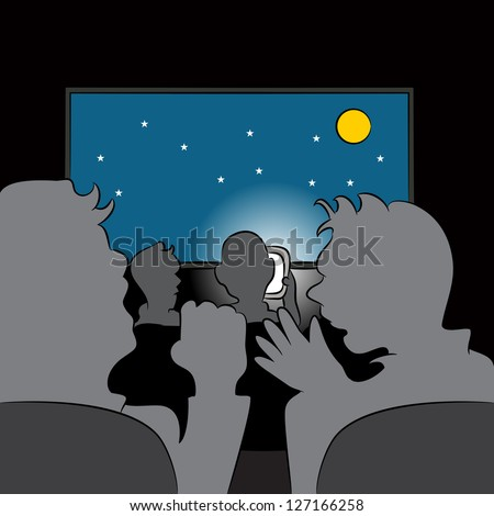 An image of a rude cellphone user in a movie theater. - stock photo
