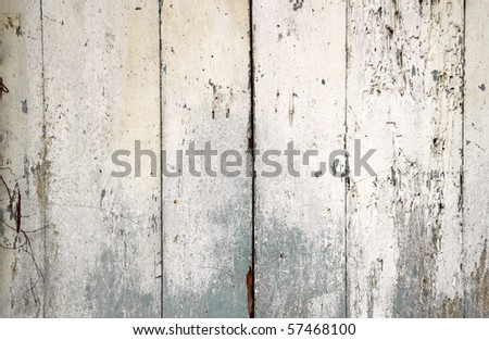 An image of a rustic weathered timber plank wall. - stock photo