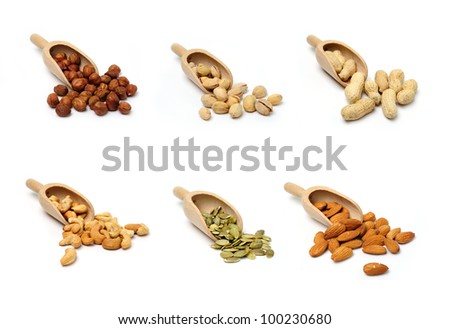 An image of a set of nuts in wooden scoops - stock photo