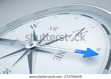 An image of a stylish compass with a blue arrow - stock photo