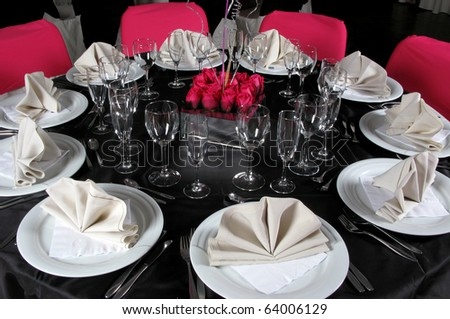 An image of a table setting at a luxury wedding reception - stock photo