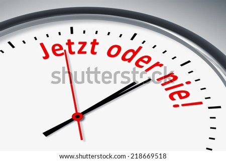 An image of a typical clock with text now or never in german language