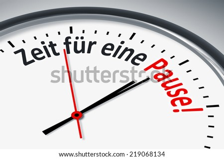 An image of a typical clock with text time for a break in german language