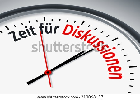 An image of a typical clock with text time for discussion in german language