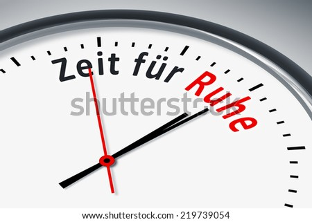 An image of a typical clock with text time for silence in german language