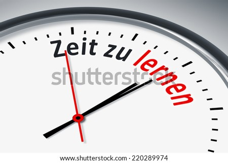 An image of a typical clock with text time to learn in german language