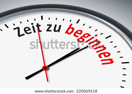 An image of a typical clock with text time to start in german language