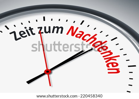 An image of a typical clock with text time to think in german language