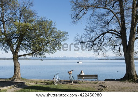 An image of a woman having a rest at Starnberg lake - stock photo