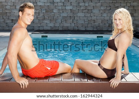 An image of a young couple at the pool - stock photo