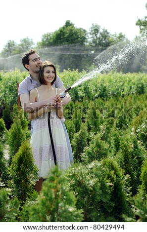An image of a young couple in the garden - stock photo
