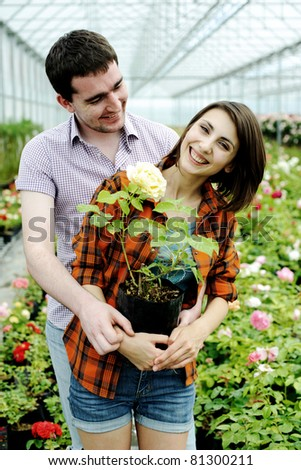 An image of a young couple with a flower pot