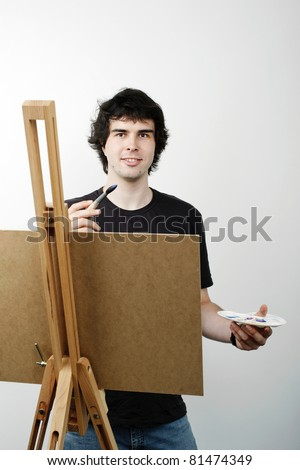 An image of a young man drawing a picture - stock photo