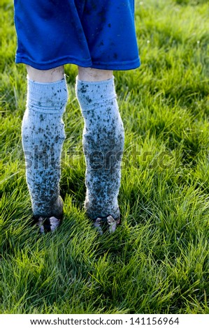 An image of a young soccer player's muddy uniform after a game