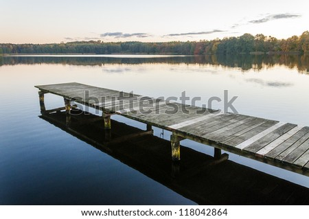 An image of amazing sunset at the lake - stock photo