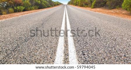 An image of an Australian desert road - stock photo