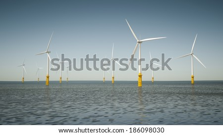An image of an offshore wind energy park - stock photo