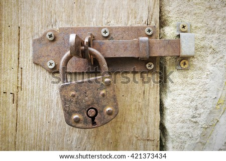 An image of an old rusty lock - stock photo