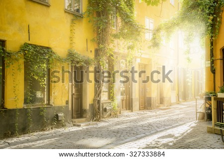 An image of an old street in Stockholm in the evening light - stock photo