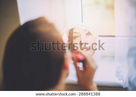 An image of beauty Girl with Makeup Brush.  - stock photo