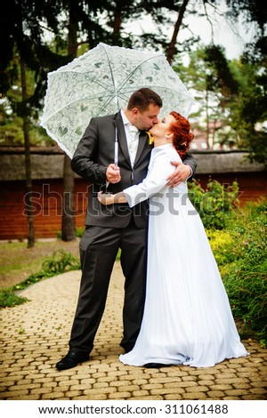 an image of bride and groom in a park