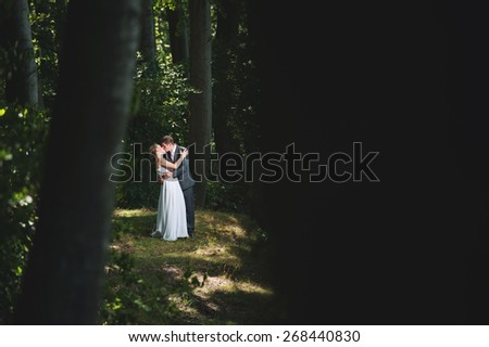 an image of bride and groom in forest - stock photo
