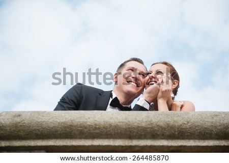 an image of bride and groom outdoors, in buildings - stock photo