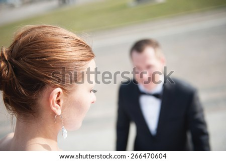 an image of bride and groom outdoors, in buildings