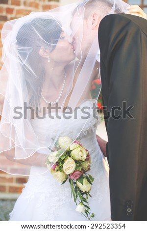 an image of bride and groom walking around the city