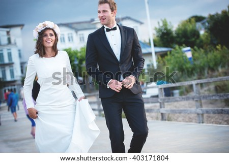 an image of bride and groom walking around town
