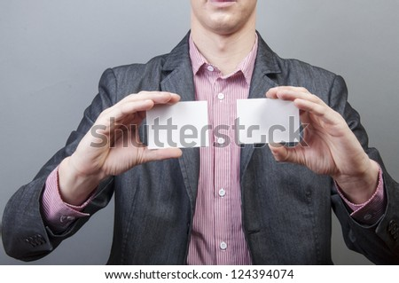 An image of businessmen holding blank card