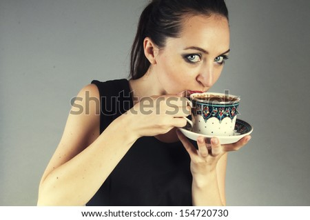 an image of businesswoman drink coffee