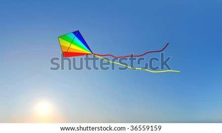 An image of colored kite and sunset on blue baclgrounds.