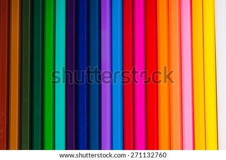 an image of Crayons. Colored Pencils. colored pencils on white background and wood chips - stock photo